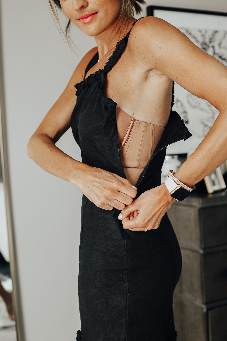 zipping up tight dress of world's most comfortable strapless bra that stays in place