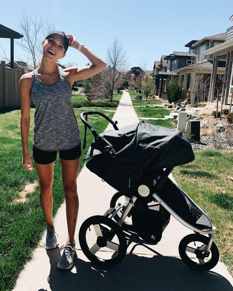 lauren kay sims pushing stroller wearing favorite lululemon hotty hot long shorts