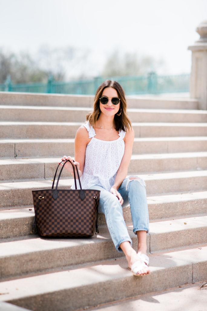 louis vuitton neverfull MM damier ebene handbag carried by fashion blogger lauren kay sims wearing blue jeans and white eyelet top