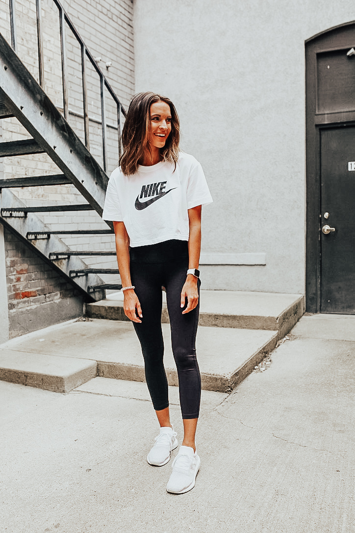 lauren sims wearing nordstrom anniversary sale workout clothes black zella leggings cropped nike workout shirt adidas running sneakers